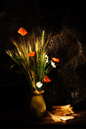 Wild flowers bouquet with wheat, poppy and ox-eye daisy  photo