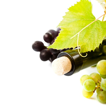 bottle of wine with leaves and grapes isolated photo