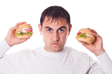 Hungry man very need a hamburger isolated on white background photo