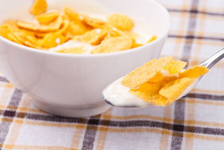 Cornflakes with yoghurt, healthy breakfast photo