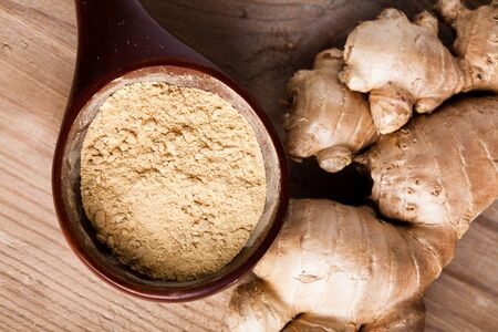 Ginger root and spice closeup on wooden table photo