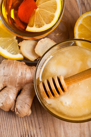 Tea with honey, lemon, and ginger. Healthcare concept for cold photo