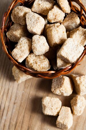 Brown sugar, natural cubes closeup photo