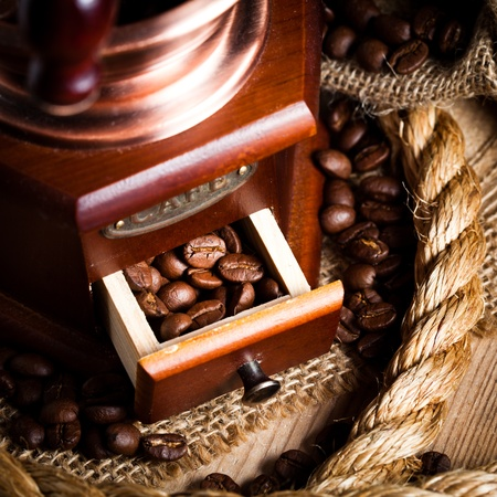 Coffee in grinder and rope still life photo