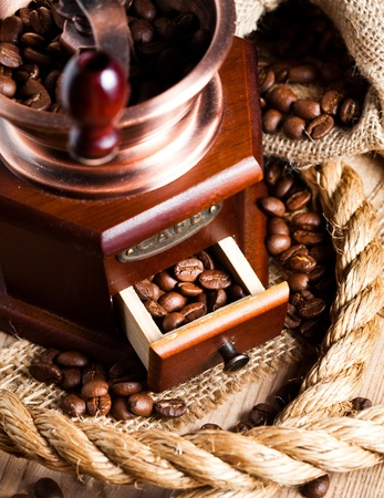 Coffee in grinder and rope still life Stock Photo - 13306177