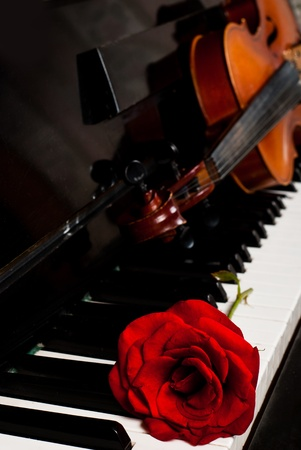 viola: Violin and piano closeup with red rose for concert advertisement with copy-space