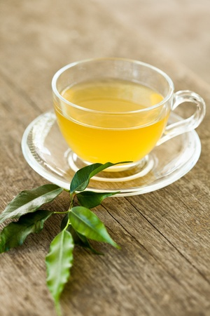 jasmine: Green tea in glass cup  on wooden table