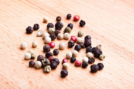 Different peppercorns on wooden table closeup Stock Photo - 13306171