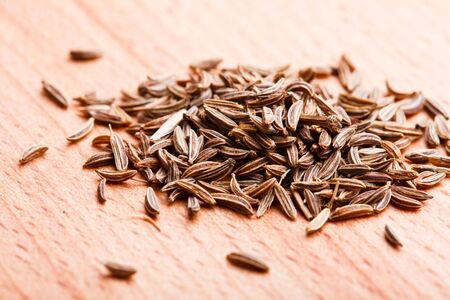 Caraway spice scattered on wooden table Stock Photo - 13306174