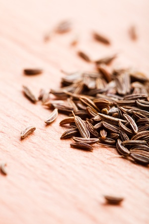 Caraway spice scattered on wooden table Stock Photo - 13306161