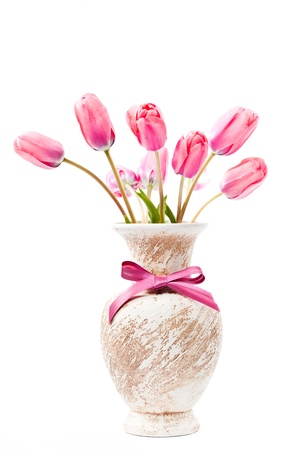 Pink tulips in vase with bow isolated on white Stock Photo - 13501317