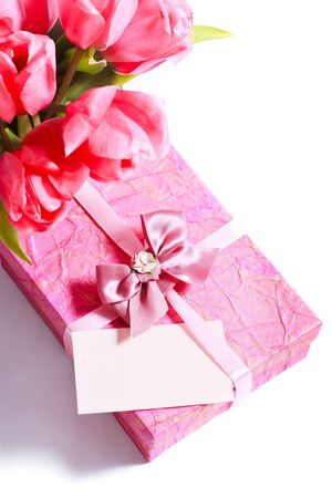 Pink tulips with card and present closeup photo