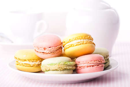 Colourful macaroons on the plate photo