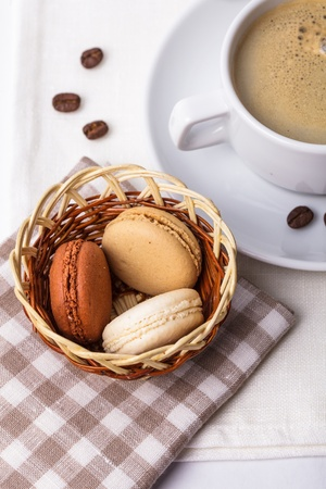 Three colors of macaroons in brown and beige tones photo