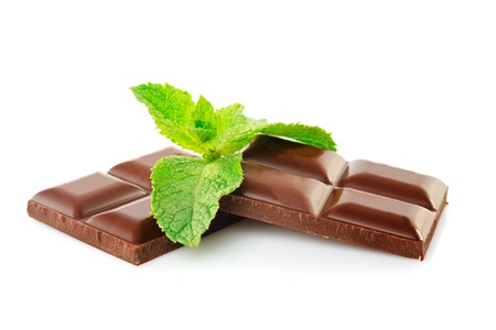 mint leaves: Green leaf of mint with dark chocolate isolated on white