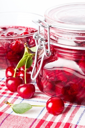 Cherry jam with fresh fruits on white photo