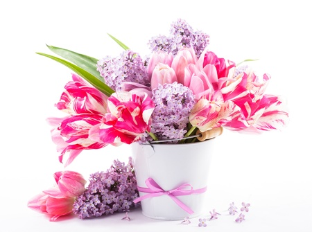 Bouquet from pink tulips and lilac on white photo