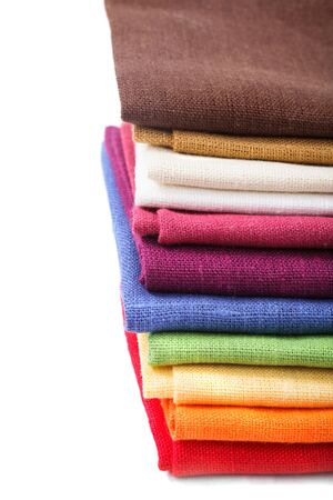 Colourful flax texrile heap for a tableware photo