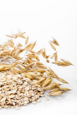 oat plant: Oat flakes heap isolated on white background