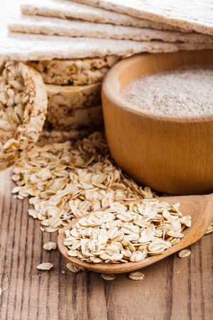 Various dietary oat products on wooden table photo