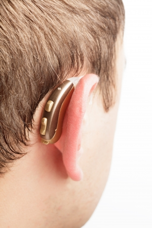Hearing aid on the man s ear closeup photo