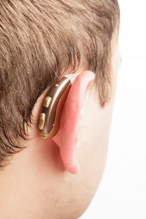 hearing aid: Hearing aid on the man s ear closeup