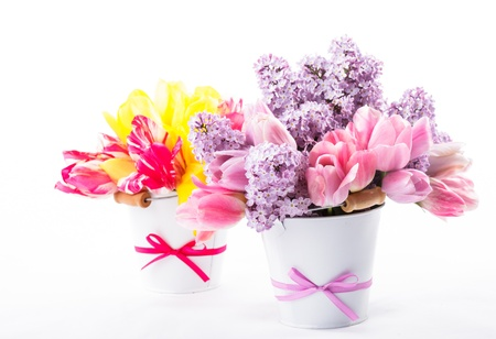 Bouquets from tulips and lilac on white photo
