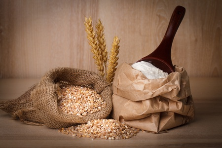 Meal in sack with wooden spoon closeup photo