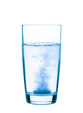 painkiller: Aspirin in a glass closeup, healthy concept
