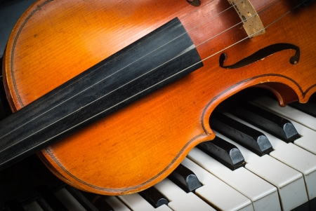 musical instruments: Violin and piano keyboard closeup part fot music background Stock Photo