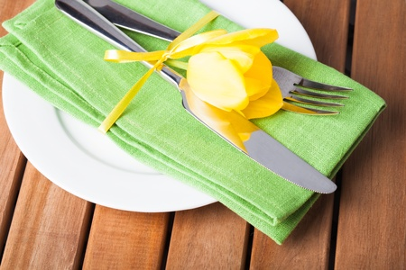 Fork and knife and plate, served for dinner photo