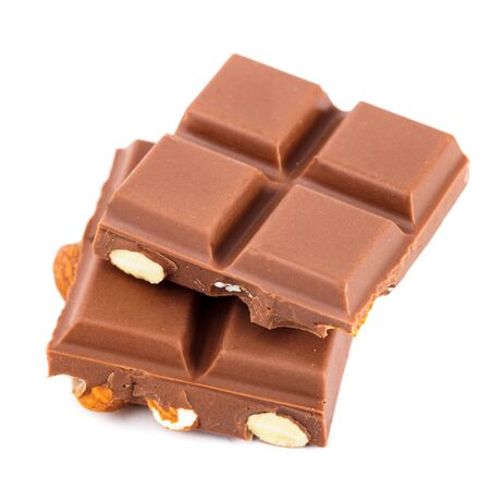 sweetmeats: Tile milk chocolate with almonds closeup on white