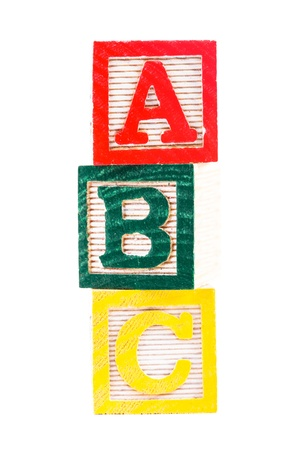Color wooden alphabet blocks isolated on white photo