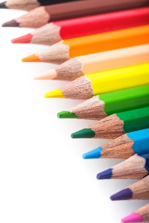 Rainbow color pencils in a row isolated on white Stock Photo - 14848370