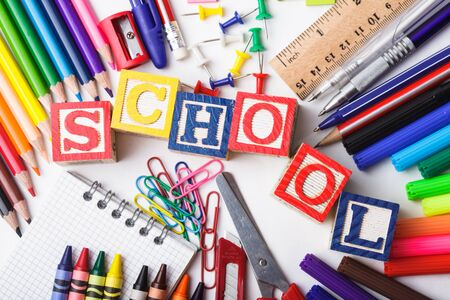 Primary school stationery on a white background photo