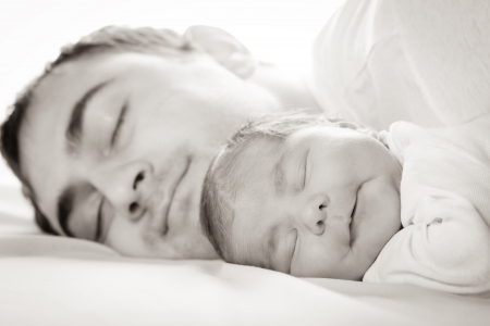 Sleep baby with dad, closeup faces photo