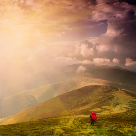 Tourist on the path high up in Carpathian mountains photo
