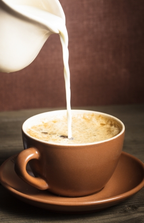 Coffee cup  and a pouring milk photo