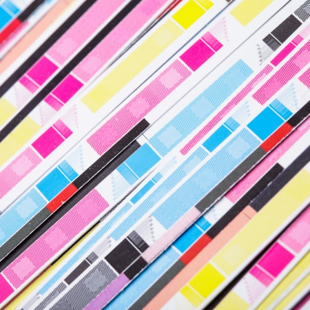 outputs: CMYK color on printed sheets of paper after cutting