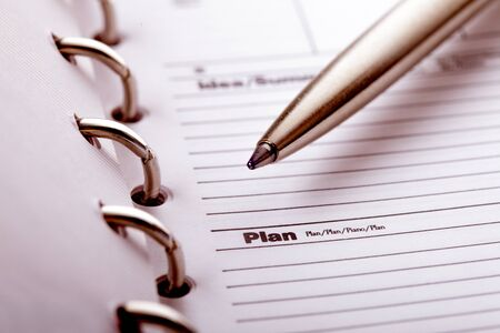 dayplanner: The word plan and pen closeup in organizer Stock Photo