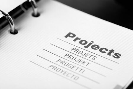 The word projects in different languages closeup in organizer Stock Photo - 16396855