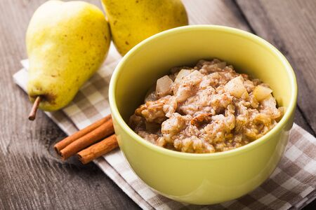 Oatmeal with pears and cinnamon and walnut photo