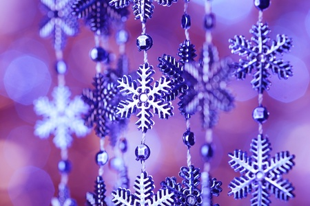 Blue snowflakes on the  lashing over bokeh background photo