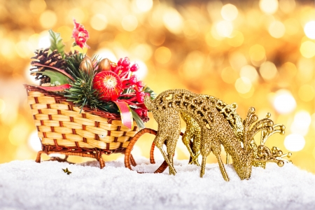 Christmas sleigh with decor and reindeers in the snow photo