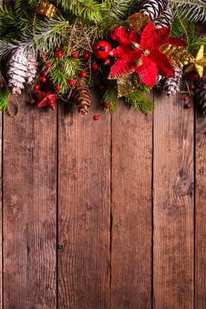 poinsettia: Christmas border design on the wooden background Stock Photo