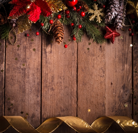 poinsettia: Christmas border design with red and gold baubles Stock Photo