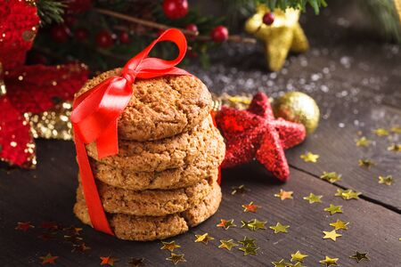 Christmas cookies on the table with red ribbon Stock Photo - 16876723
