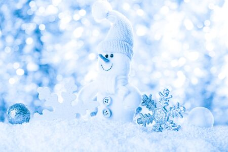 blue toned: Snow and bokeh - christmas background for design Stock Photo