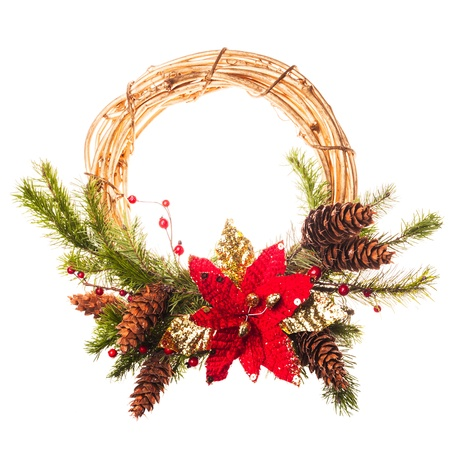 Christmas wreath with poinsettia and fir branches photo