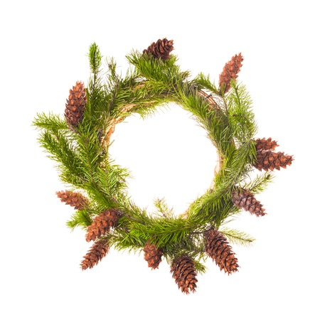 Christmas wreath from spruce branches with cones photo